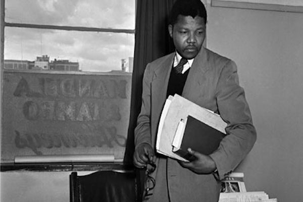 Nelson Mandela at work in the Johannesburg office where he and Oliver Tambo practised law together during the apartheid era. Photograph: Jurgen Schadeberg