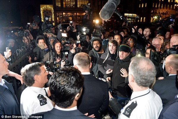 Crowds hurl abuse at Assistant Commissioner Rowley after a jury ruled that Mark Duggan was lawfully killed.